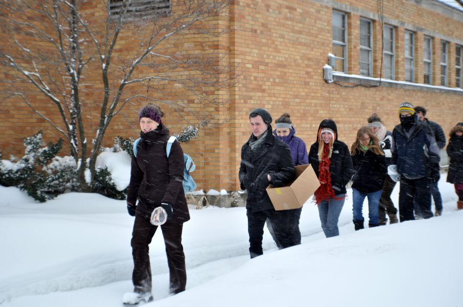 Walking in the snow to find impressions and discuss historical context for infrastructure